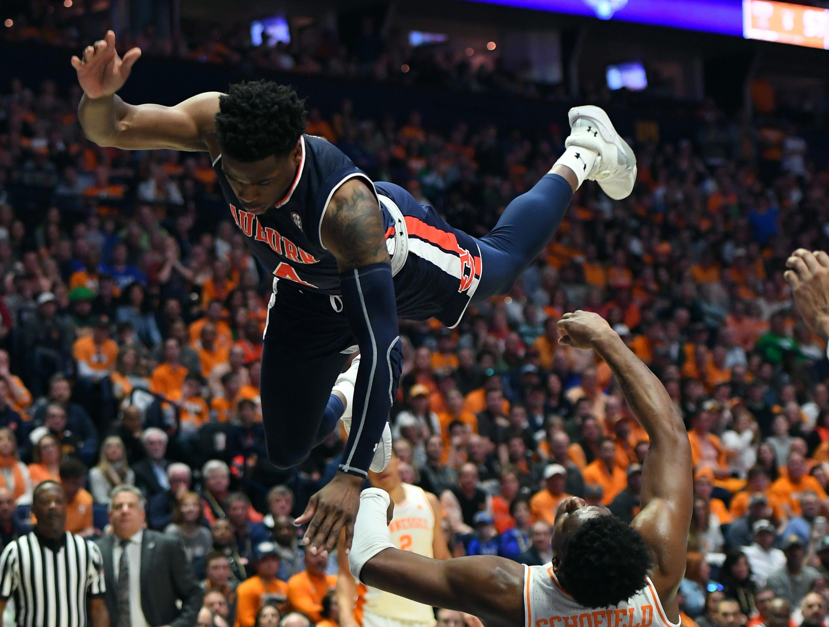 Mar 17, 2019; Nashville, TN, USA; Auburn Tigers guard Malik Dunbar (4) shoots the ball over Tennessee Volunteers guard Admiral Schofield (5) on a drive to the basket during the second half in the SEC conference tournament championship game at Bridgestone Arena. Mandatory Credit: Christopher Hanewinckel-USA TODAY Sports