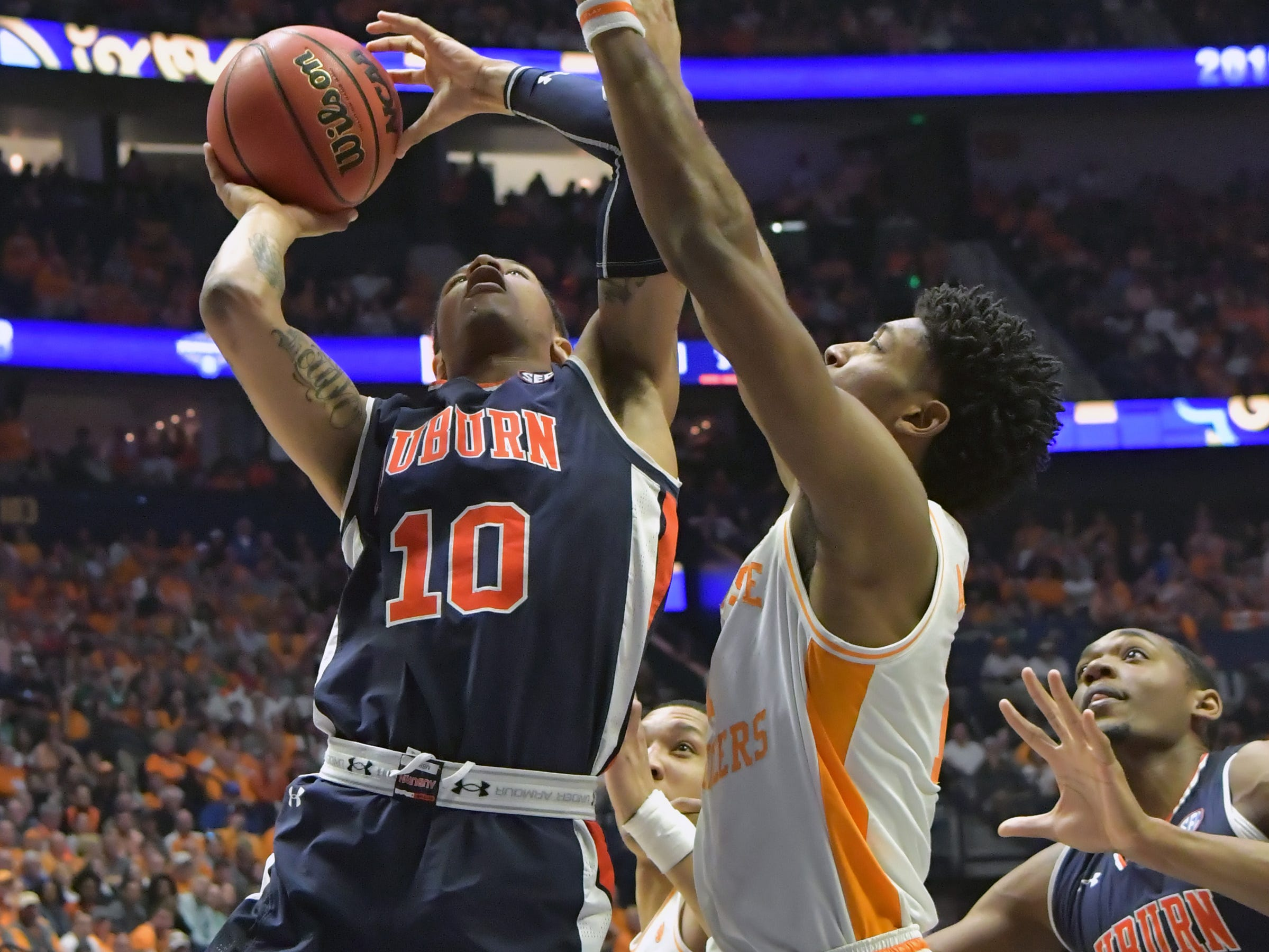 Mar 17, 2019; Nashville, TN, USA; Auburn Tigers guard Samir Doughty (10) shoots against Tennessee Volunteers during the first half of the championship game in the SEC conference tournament at Bridgestone Arena. Mandatory Credit: Jim Brown-USA TODAY Sports