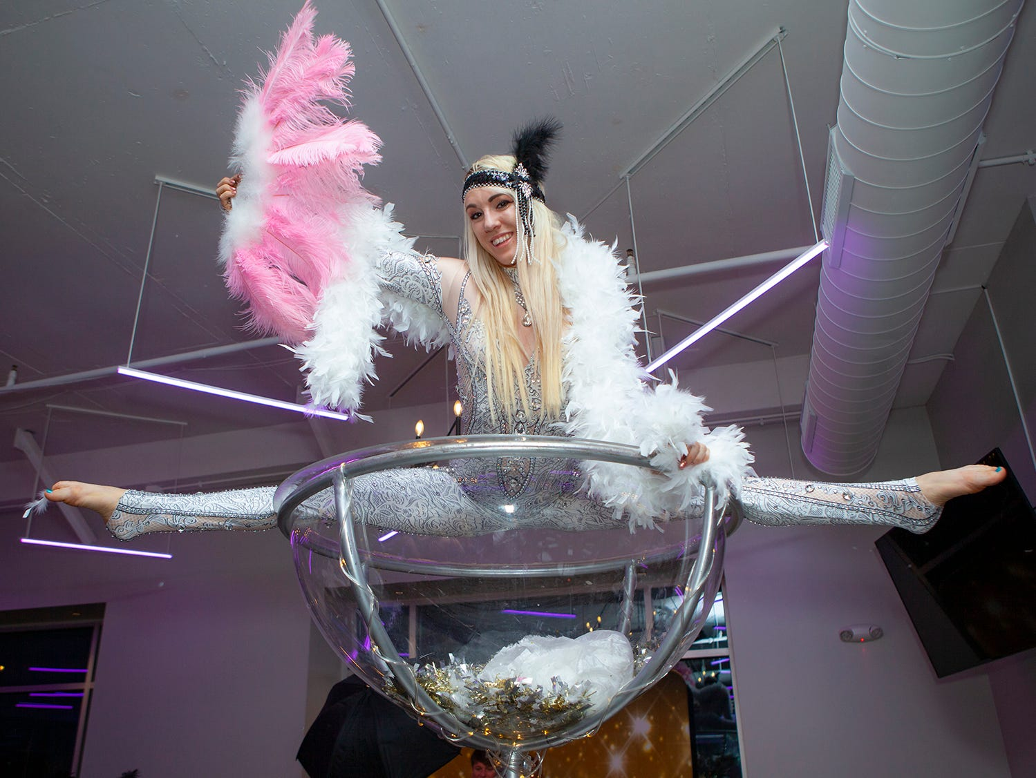 Grace Good with Beyond Wings Circus entertains the crowd at The Gatsby Party, hosted by the Alzheimer's Association at The View at Fountains Saturday, March 16, 2019.