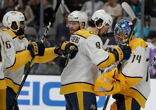 Nashville Predators goalie Juuse Saros, right, celebrates with Filip Forsberg (9) after the team's 4-2 win over the San Jose Sharks on Saturday, March 16, 2019, in San Jose, Calif.