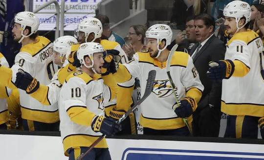 Nashville Predators' Colton Sissons (10) is congratulated after scoring a goal against the San Jose Sharks during the first period of an NHL hockey game Saturday, March 16, 2019, in San Jose, Calif.