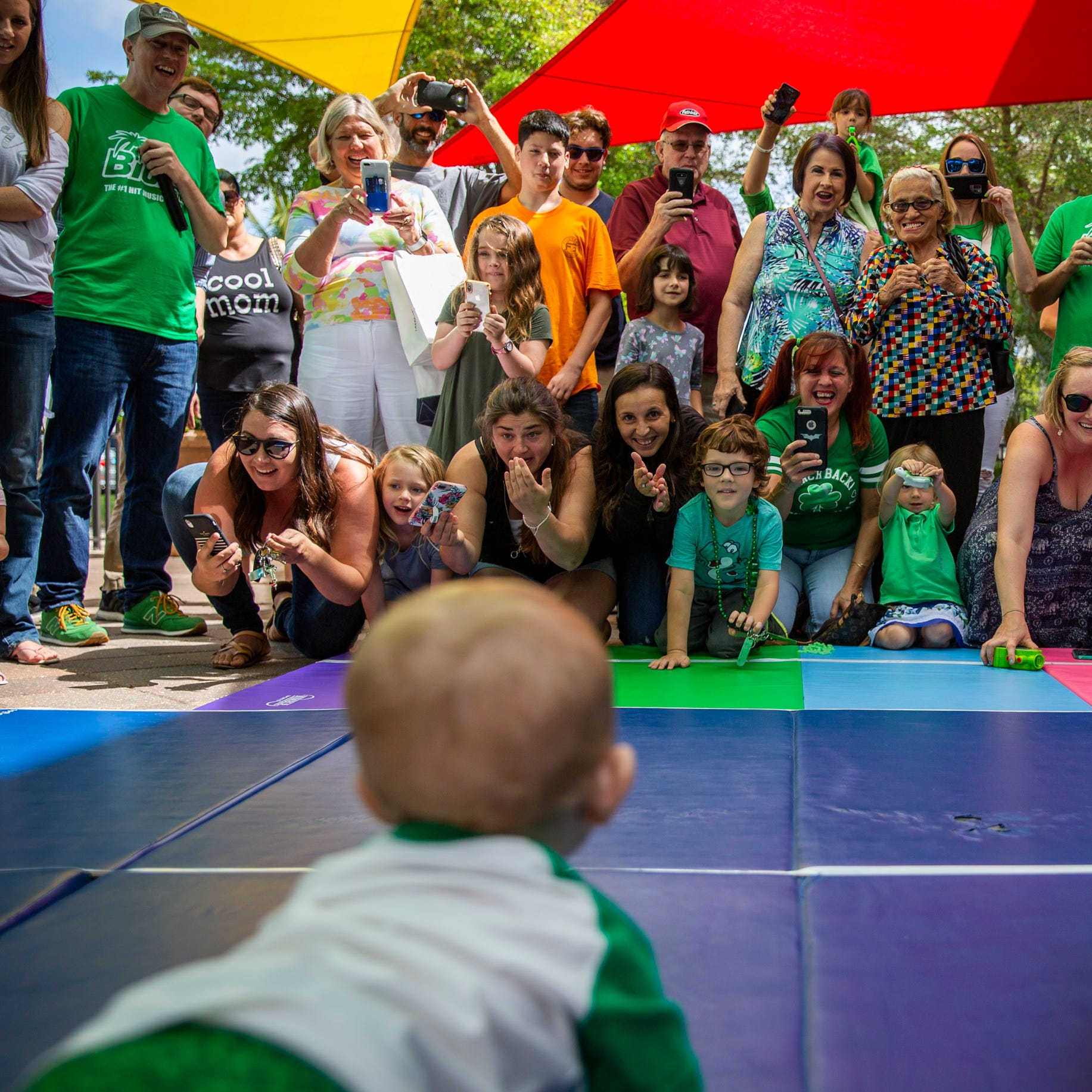 Baby Leprechauns compete in a kooky St. Patrick's Day race