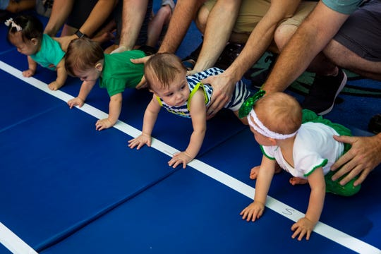 Babies line up before the start of a race during the Baby Leprechaun Races at Miromar Outlets in Estero on Sunday, March 17, 2019.