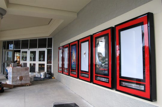 """The """"now showing"""" poster displays were recently refurbished as part of the renovation work at Hollywood 20 cinema in North Naples."""