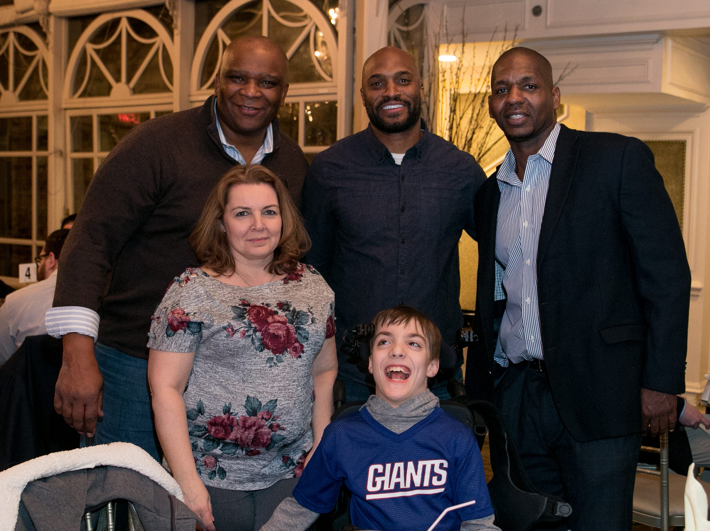Former NY Giants Howard Cross, Amani Toomer and Sam Garnes with Tracy and Matthew Kulick. Rebuilding Together North Jersey held its third annual Beefsteak Dinner with former NY Giants Howard Cross, Amani Toomer, and Sam Garnes at the Brownstone in Paterson. 03/07/2019