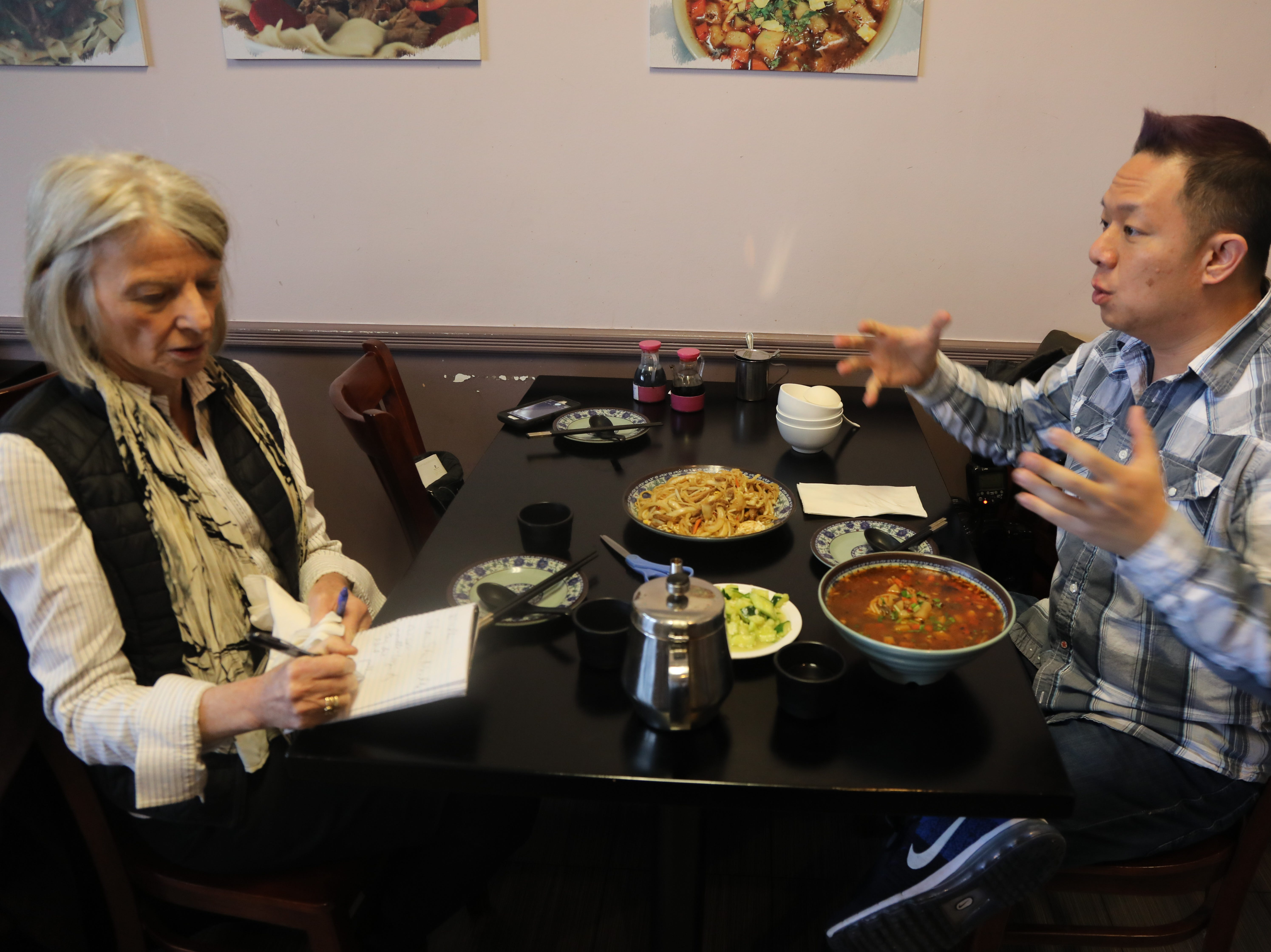 Esther Davidowitz and our restaurant guide Danny Chin with a selection of dishes from Shan Shan Noodles.