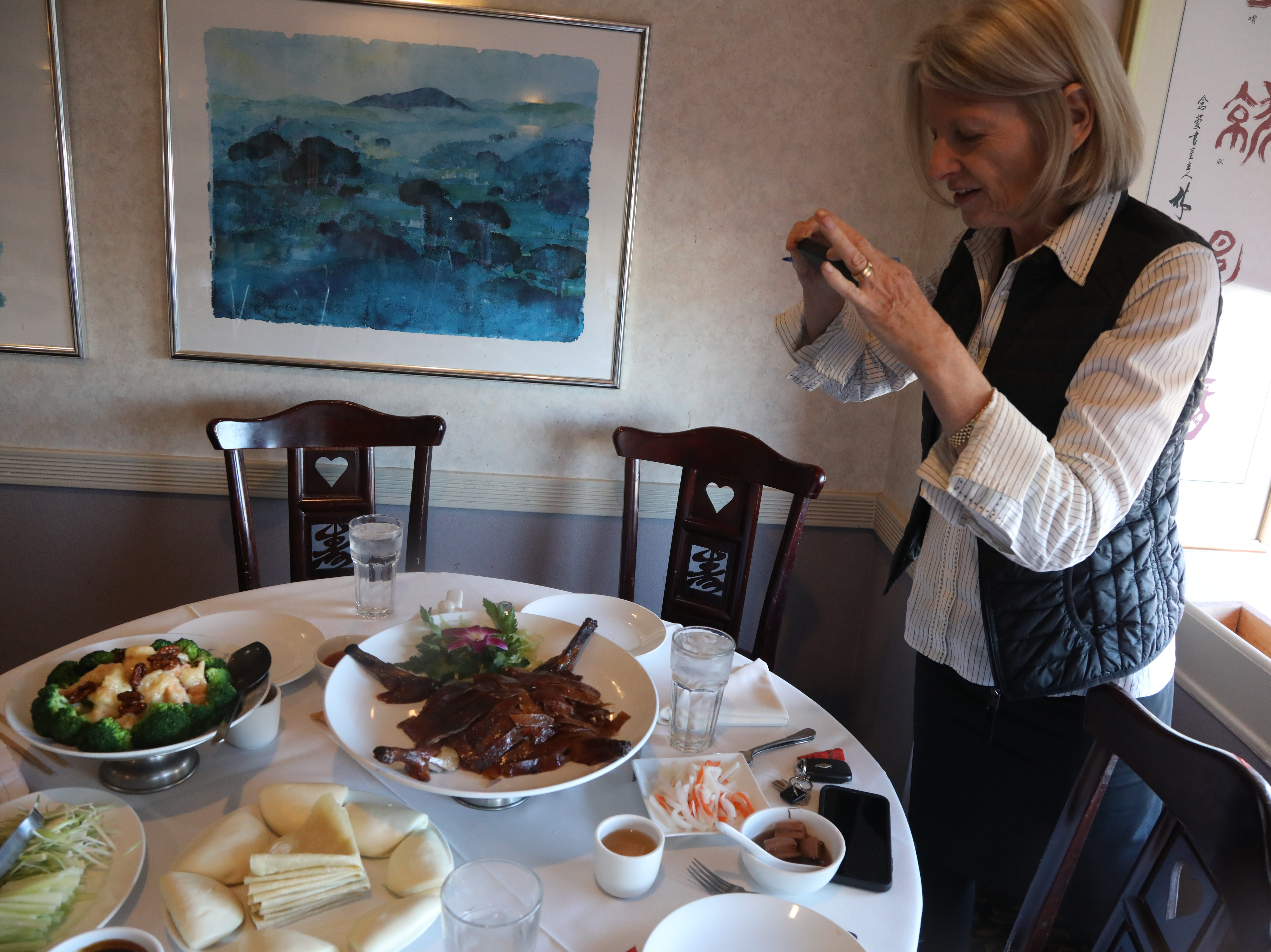 Esther Davidowitz photographing Beijing duck at Jasper Restaurant.