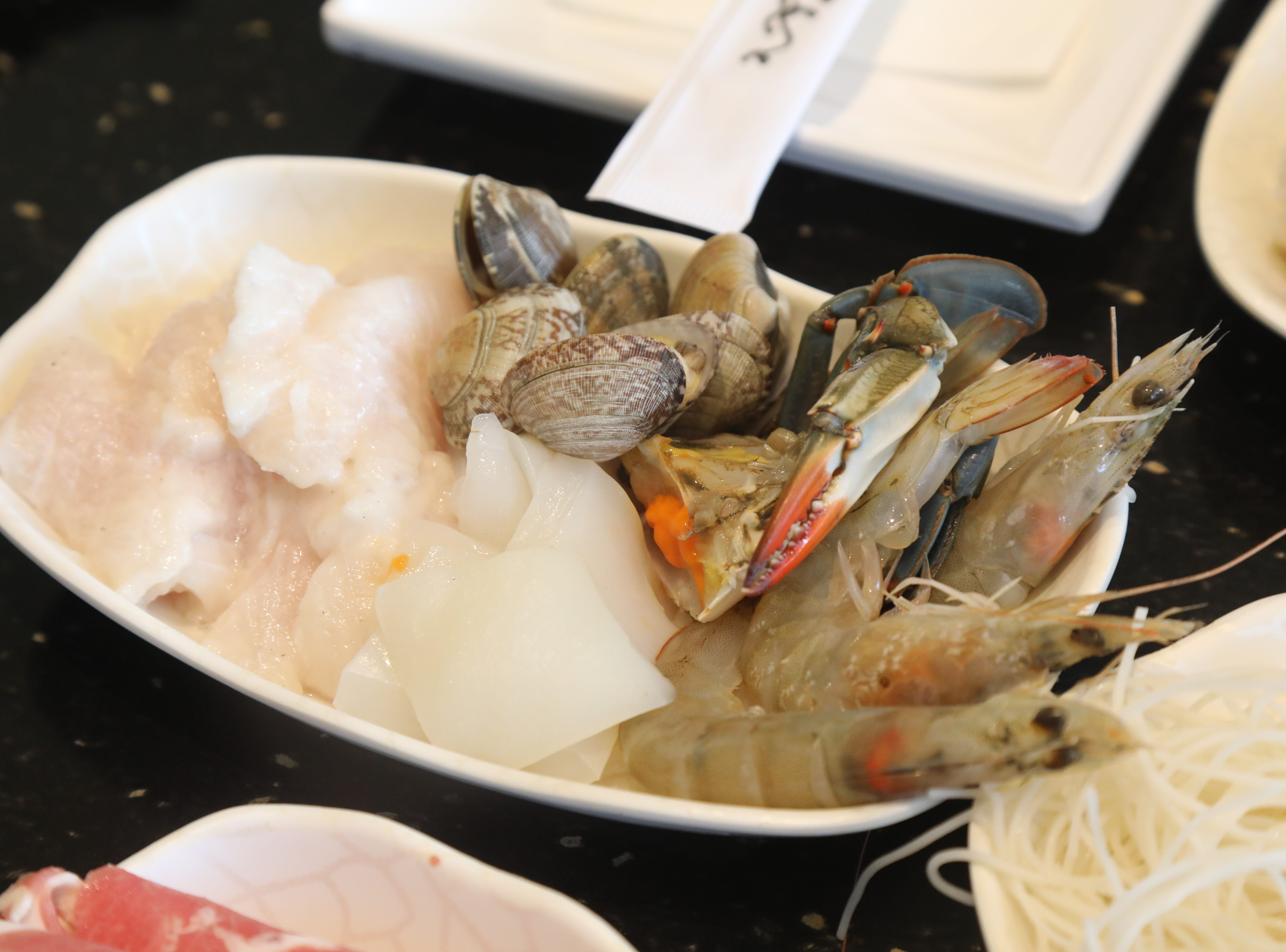 Seafood that is put into a hot broth at the dining table of V-Yan Hotpot and BBQ.
