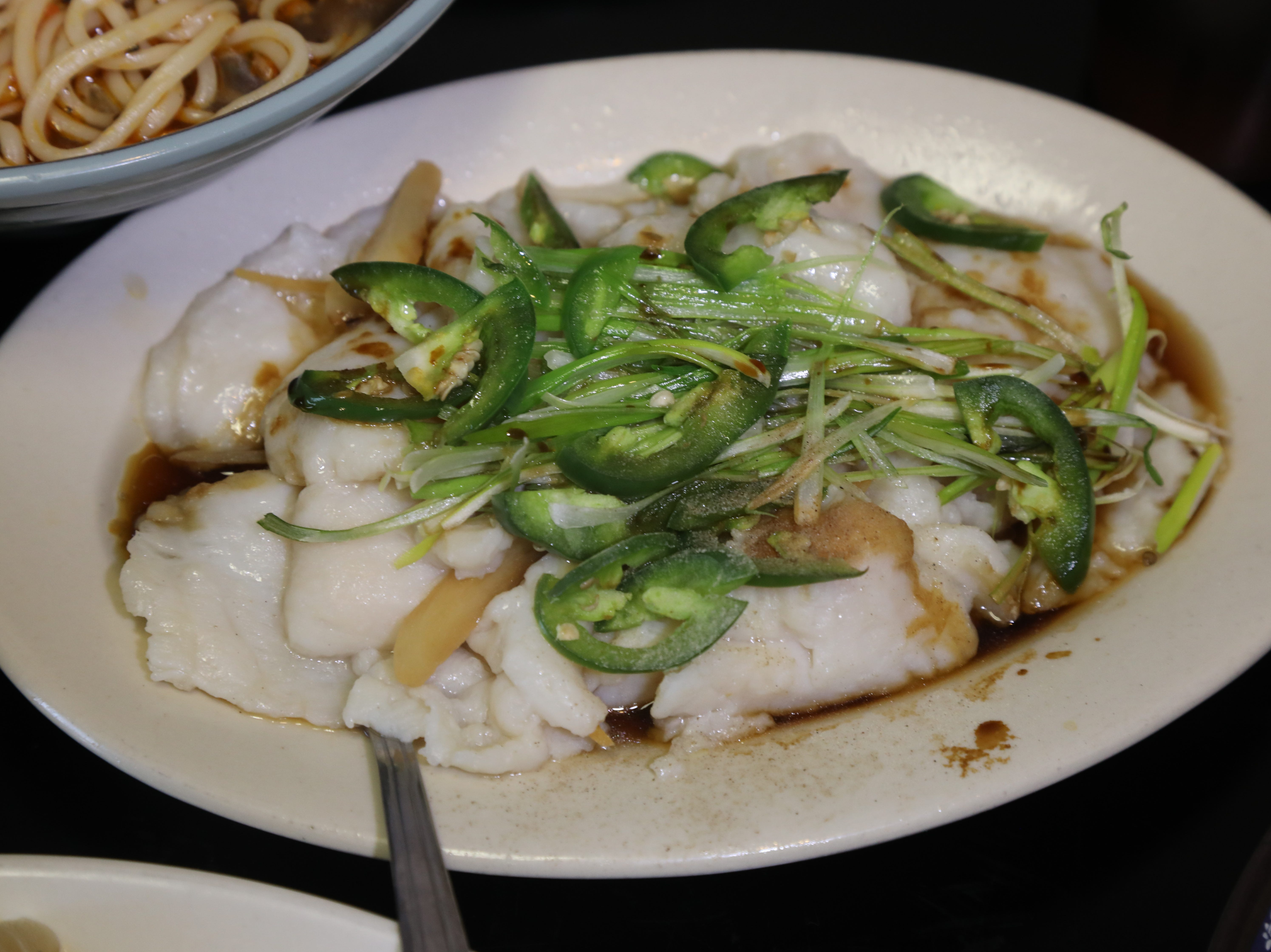 Steamed fish with jalape–o peppers from Shan Shan Noodles.