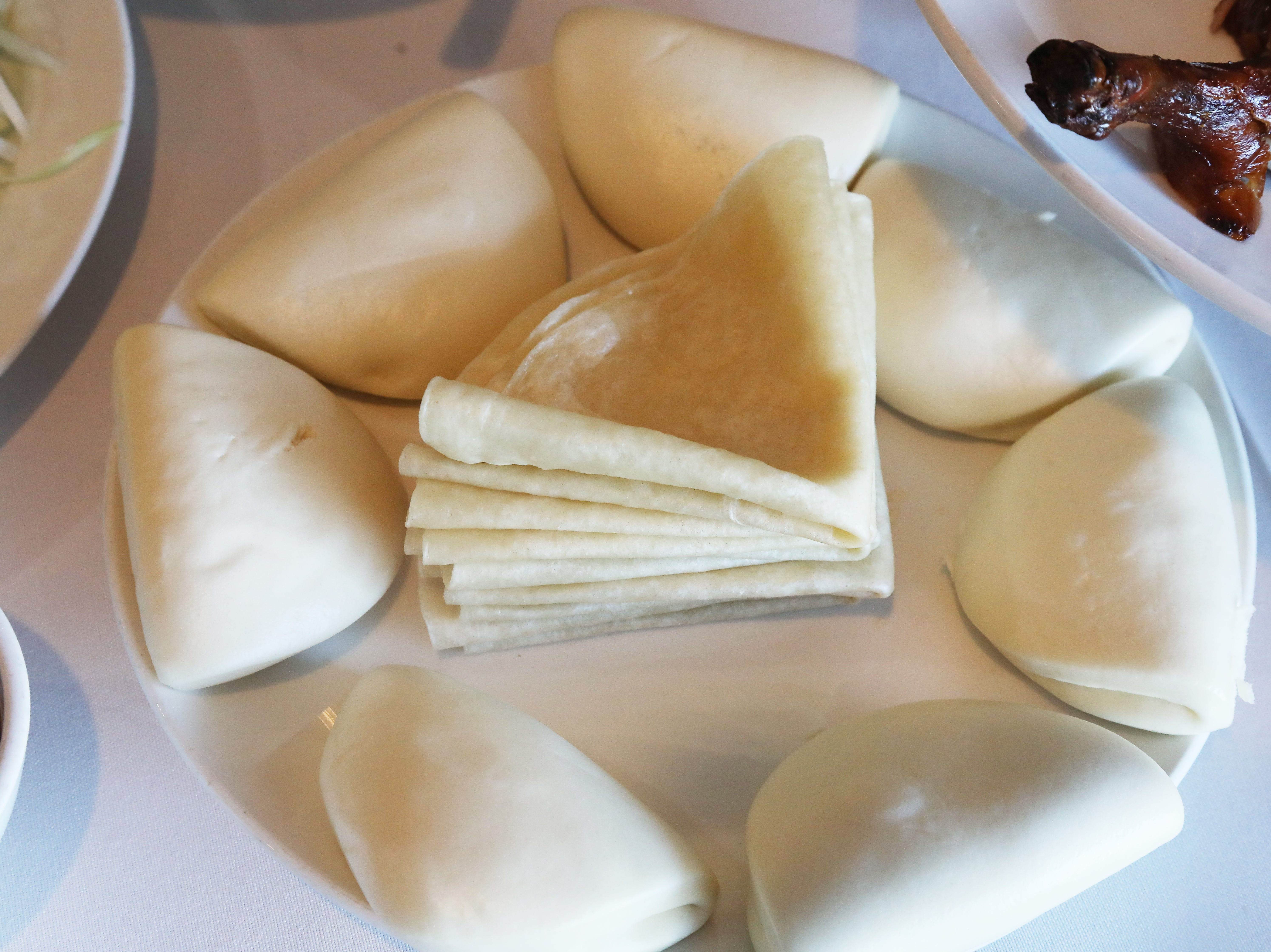 Pancakes and buns that are served so they can be stuffed with Beijing duck at Jasper Restaurant.