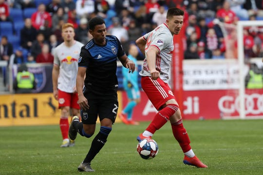 New York Red Bulls midfielder Alex Muyl, right, and San Jose Earthquakes defender Marcos Lopez fight for the ball during the second half of an MLS soccer game, Saturday, March 16, 2019, in Harrison, N.J. The New York Red Bulls won 4-1.