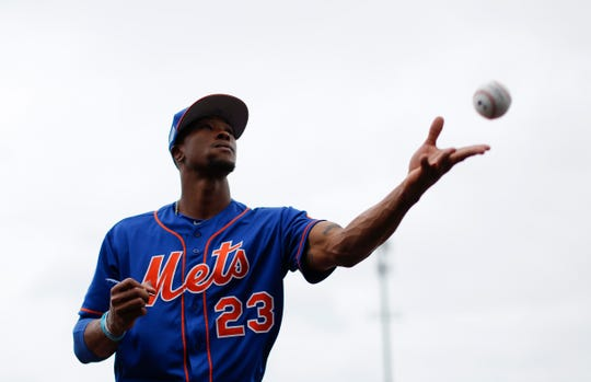 New York Mets center fielder Keon Broxton (23) throws a signed ball to a fan before an exhibition spring training baseball game against the Miami Marlins on Saturday, March 16, 2019, in Jupiter, Fla.