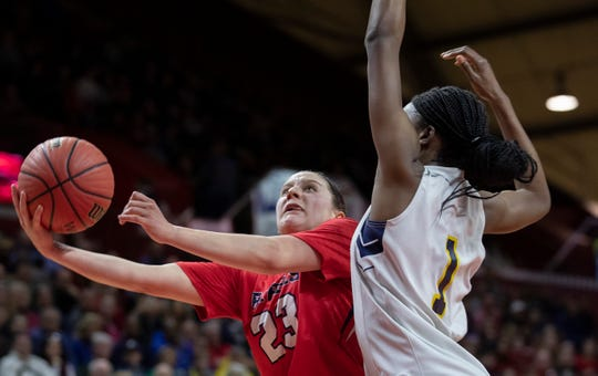 Saddle River Day's Michelle Sidor (23) drives to the basket against Franklin's Diamond Miller (1). 2019 NJSIAA girls basketball Tournament of Champions final in Piscataway, N.J. on March 17, 2019.