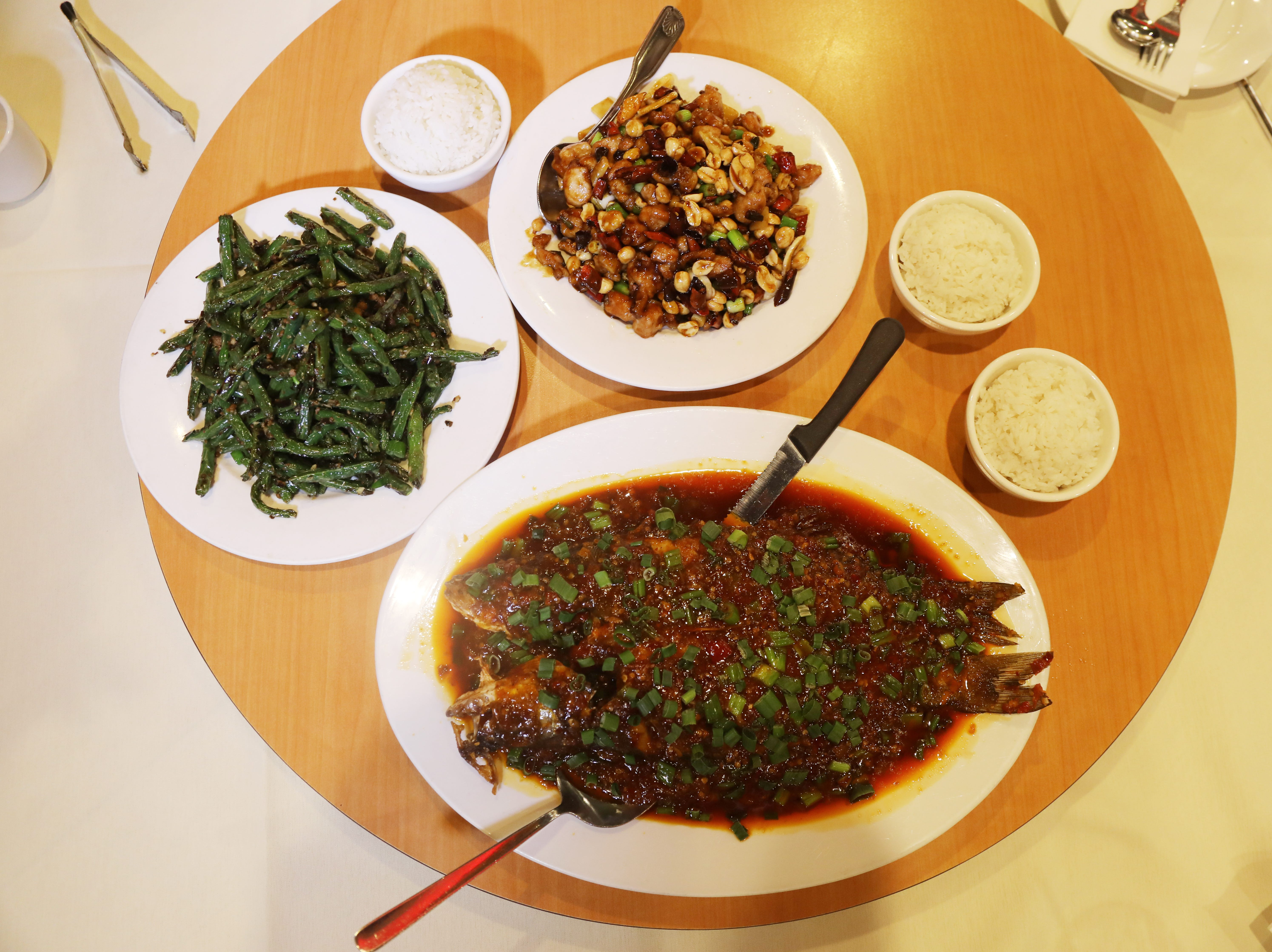 Asparagus, Kung Pao chicken and whole fish with Cheng Du hot bean paste and chili sauce at Cheng Du 23 in Wayne.