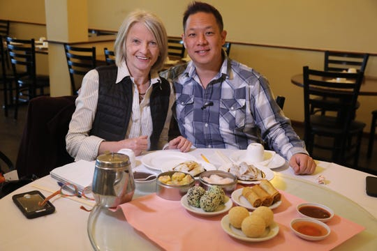 Esther Davidowitz and food blogger Danny Chin with a large selection of appetizers at Noodle Wong.