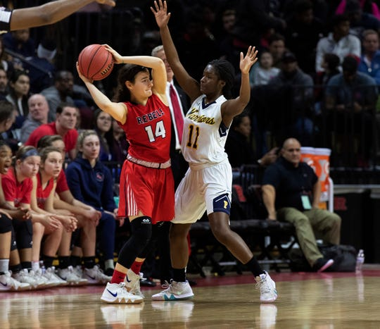 Saddle River Day's Jordan Janowski (14) tries to pass the ball as Franklin's Kennady Schenck defends. 2019 NJSIAA girls basketball Tournament of Champions final in Piscataway, N.J.  on March 17, 2019.