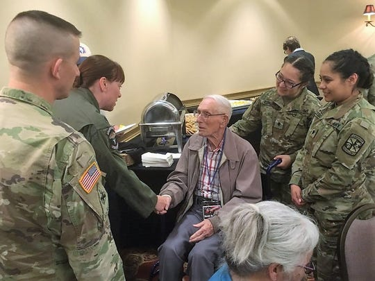 Harold Bergbower, center, greets U.S. Army service members at a Las Cruces reception for Bataan Death March survivors on Friday, March 15, 2019.