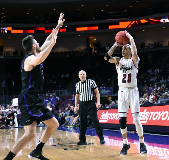 New Mexico State's Trevelin Queen knocks down a 3-pointer against Grand Canyon during Saturday's WAC championship game.