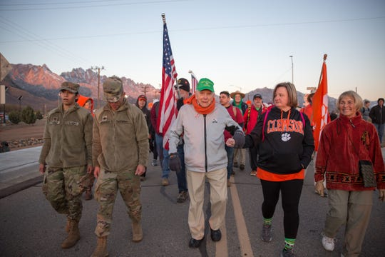 "At 101 years old, Ben Skardon, center, is the oldest living Bataan Death March survivor to attend the memorial event at White Sands Missile Range. This year, he led ""Ben's Brigade"" in an 3-mile march through the course on Sunday, March 17, 2019."