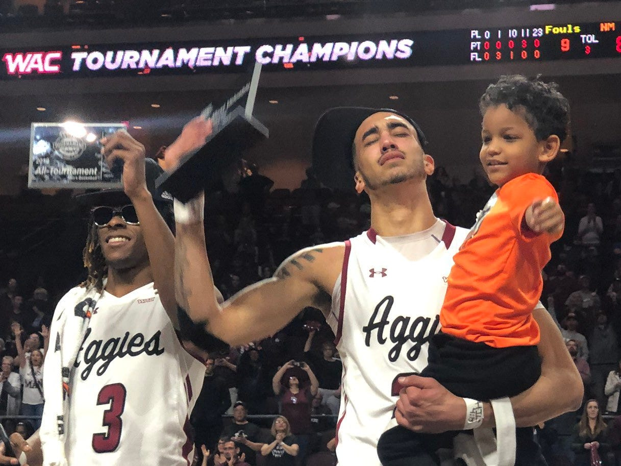 New Mexico State junior guard Trevelin Queen receives the 2019 WAC Tournament MVP award as he stands with teammate Terrell Brown (No. 3) on Saturday, March 16, 2019, in Las Vegas.