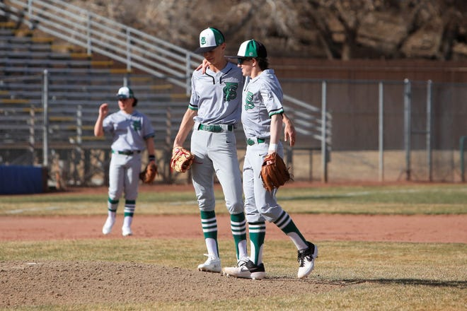 Farmington's Danny Carpenter, right, meets with Bradon Zastrow on the mound in-between at-bats against Los Lunas during a FHS Scorpion Invitational tournament game on Thursday, March 7 at Ricketts Park in Farmington. Visit daily-times.com to see the latest sports photo galleries and video highlights.