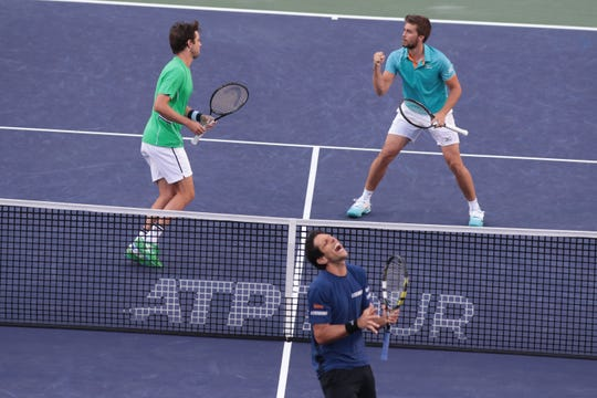 Marcelo Melo reacts after losing a point to Nikola Mektic and Horacio Zeballos in the doubles finals of the BNP Paribas Open in Indian Wells, Calif., March 16, 2019.