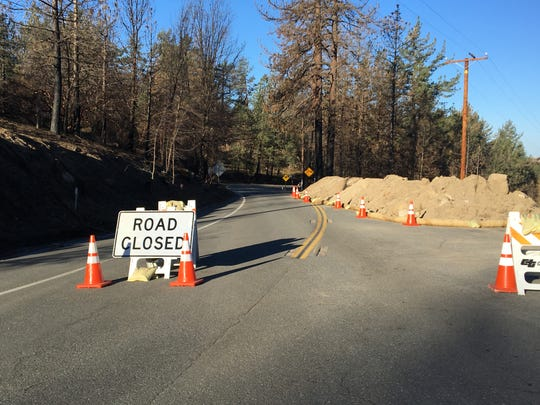 A roadblock prevents people from going down Highway 74 toward Hemet from Mountain Center. The east side of the road from Palm Desert is still open.