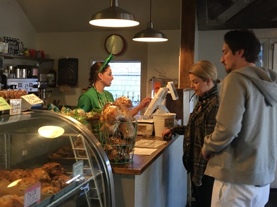Hailee Brooks serves customers at Idyllwild Bake Shop & Brew Sunday. It's among businesses affected by road closures caused by the Feb. 14 storm and owners are encouraging people to get to town via Highway 74 in Palm Desert.