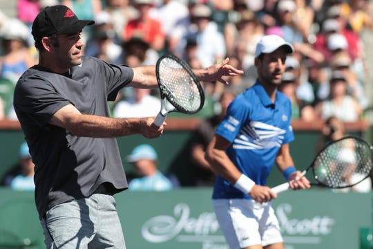 Pete Sampras hits a volley during a surprise exhibition match at the BNP Paribas Open in Indian Wells, Calif., March 16, 2019.