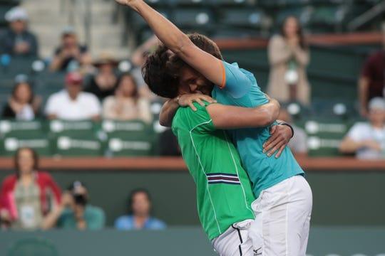 Nikola Mektic and Horacio Zeballos react after winning the doubles finals of the BNP Paribas Open in Indian Wells, Calif., March 16, 2019.