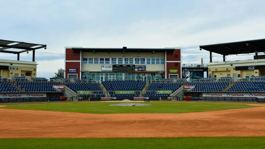 The team from River Region Sports Fields in Millbrook, Ala. installs new sod for the infield and foul line areas at Blue Wahoos Stadium.