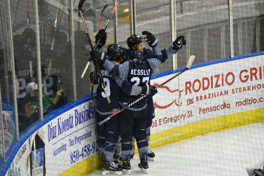The Pensacola Ice Flyers celebrate a goal during a win on March 16, 2019.