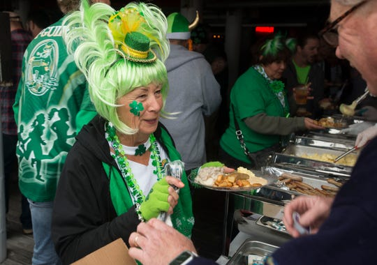"Revelers take in the spirit of St. Patrick's Day Sunday, March 17, 2019 during the ""Go Irish on the Island"" Pub Crawl at Pensacola Beach."