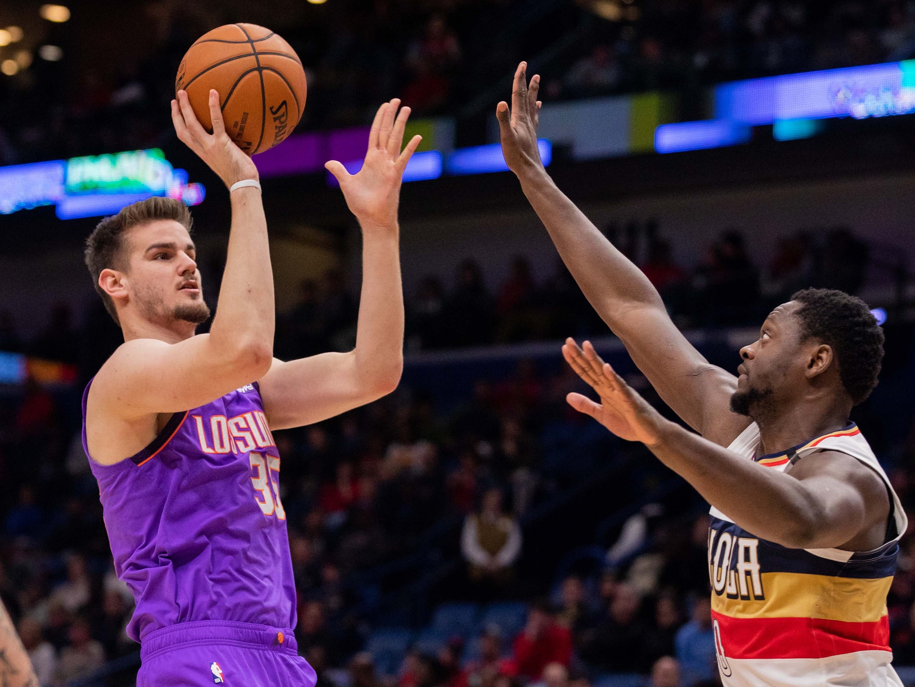 Mar 16, 2019; New Orleans, LA, USA; Phoenix Suns forward Dragan Bender (35) shoots a jump shot against New Orleans Pelicans center Julius Randle (30) during the first half at Smoothie King Center.