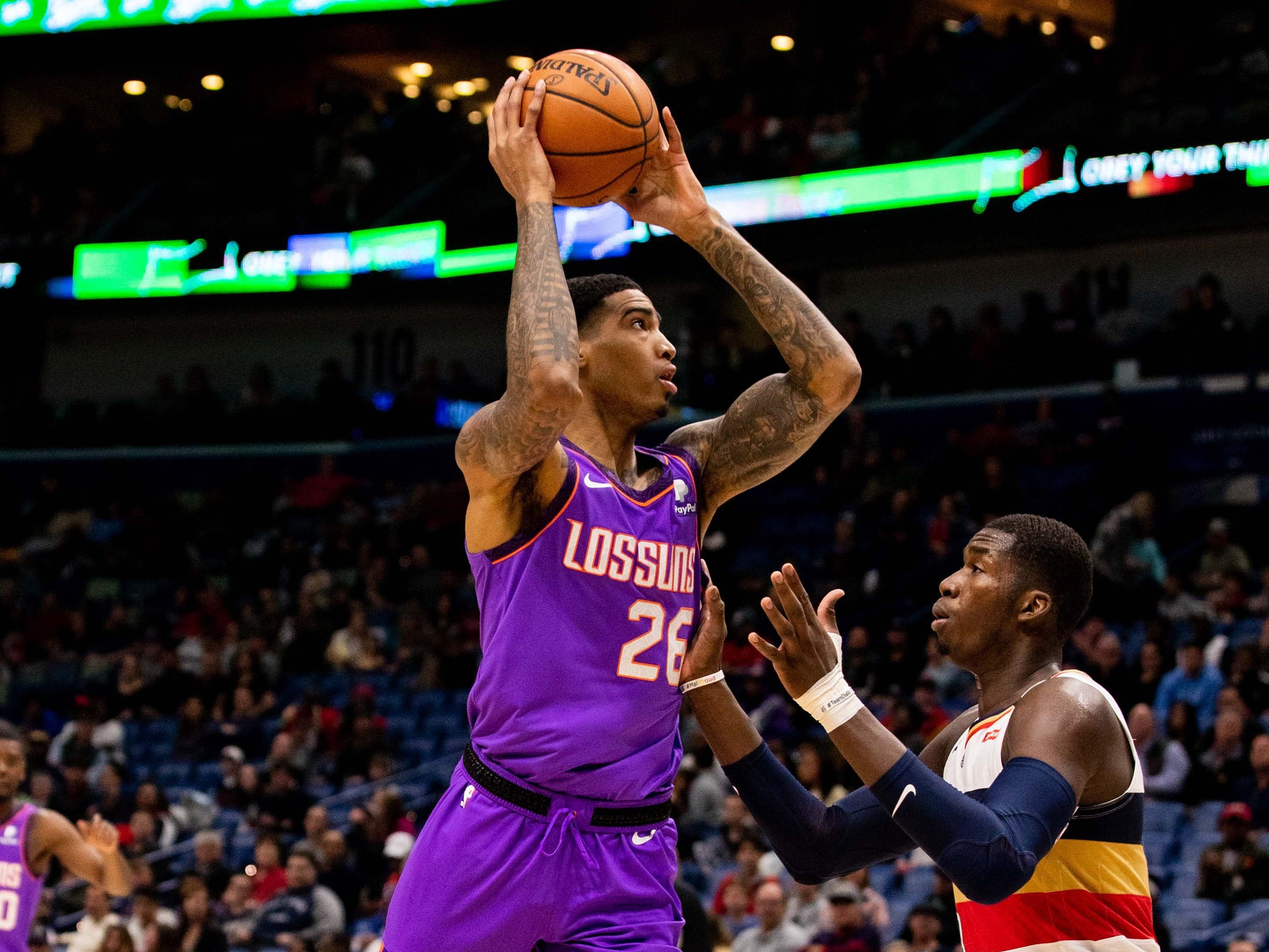 Mar 16, 2019; New Orleans, LA, USA; Phoenix Suns forward Ray Spalding (26) looks to pass against New Orleans Pelicans during the first half at Smoothie King Center.