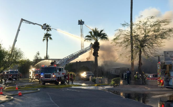 Firefighters work to put out of fire at Doc & Eddy's Bar in Tempe.