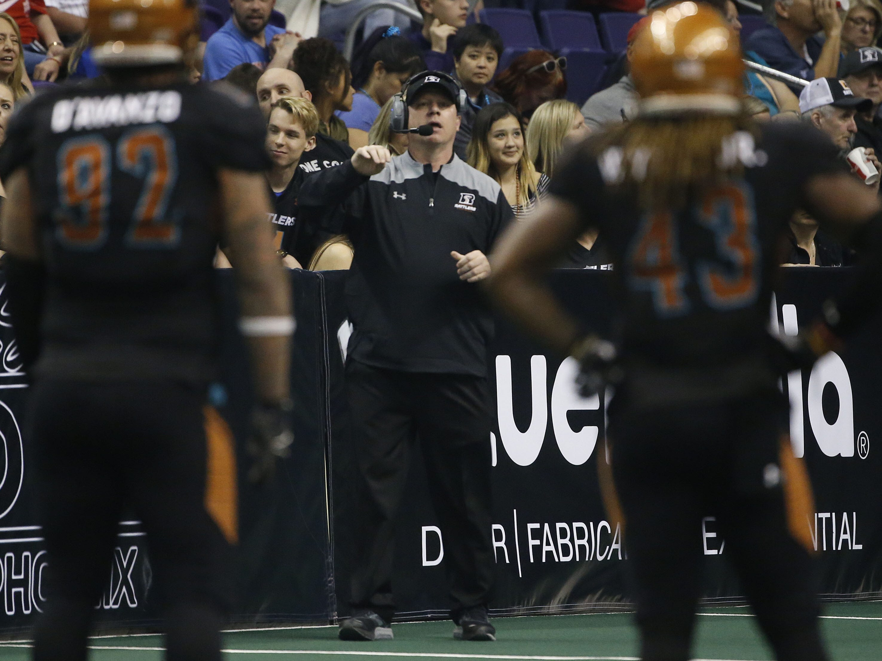 Rattlers' head coach Kevin Guy talks to his defense during the second half against the Sugar Skulls at Talking Stick Resort Arena in Phoenix, Ariz. on March 16, 2019.
