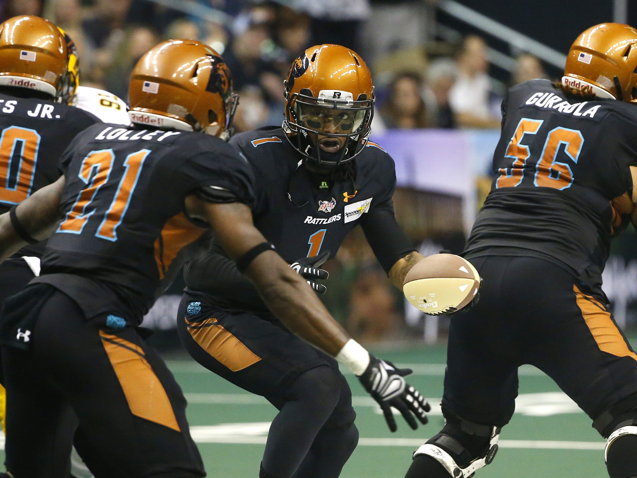 Rattlers' Verlon Reed Jr. (1) hands the ball off to Jabre Lolley (21) during the first half against the Sugar Skulls at Talking Stick Resort Arena in Phoenix, Ariz. on March 16, 2019.