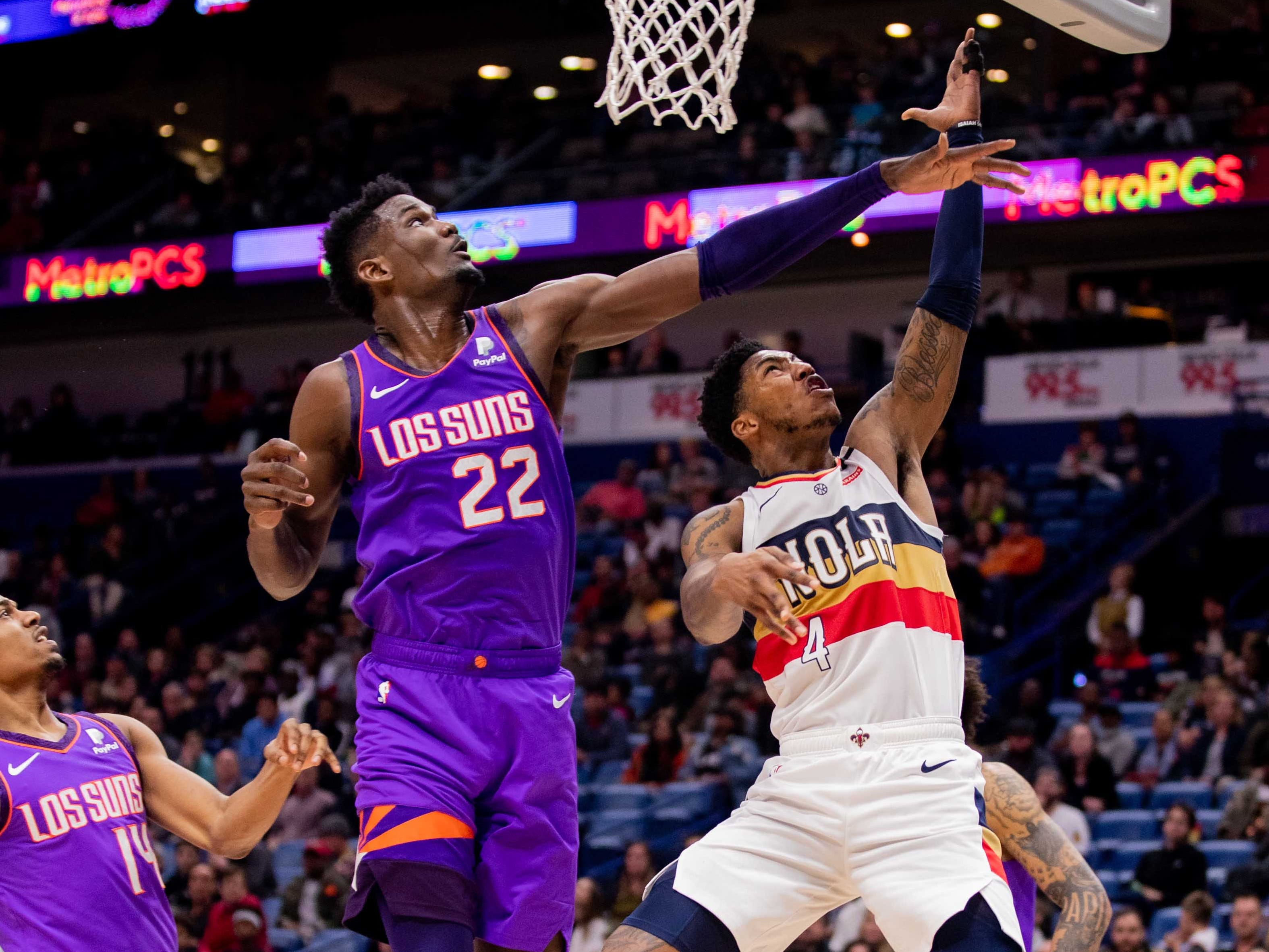 Mar 16, 2019; New Orleans, LA, USA; New Orleans Pelicans guard Elfrid Payton (4) drives to the basket against Phoenix Suns guard De'Anthony Melton (14) during the second half at Smoothie King Center.