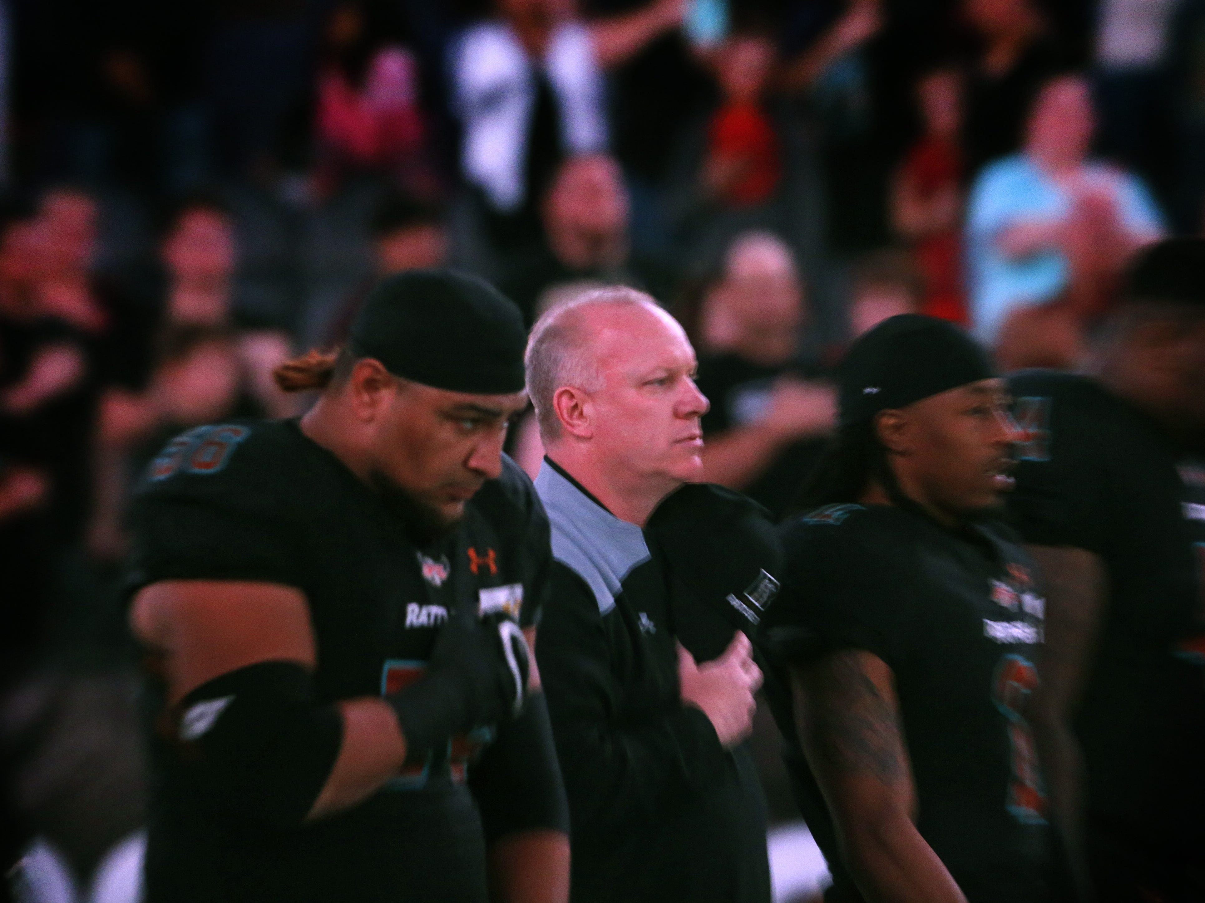 Rattlers head coach Kevin Guy listens to the national anthem before a game against the Sugar Skulls at Talking Stick Resort Arena in Phoenix, Ariz. on March 16, 2019.