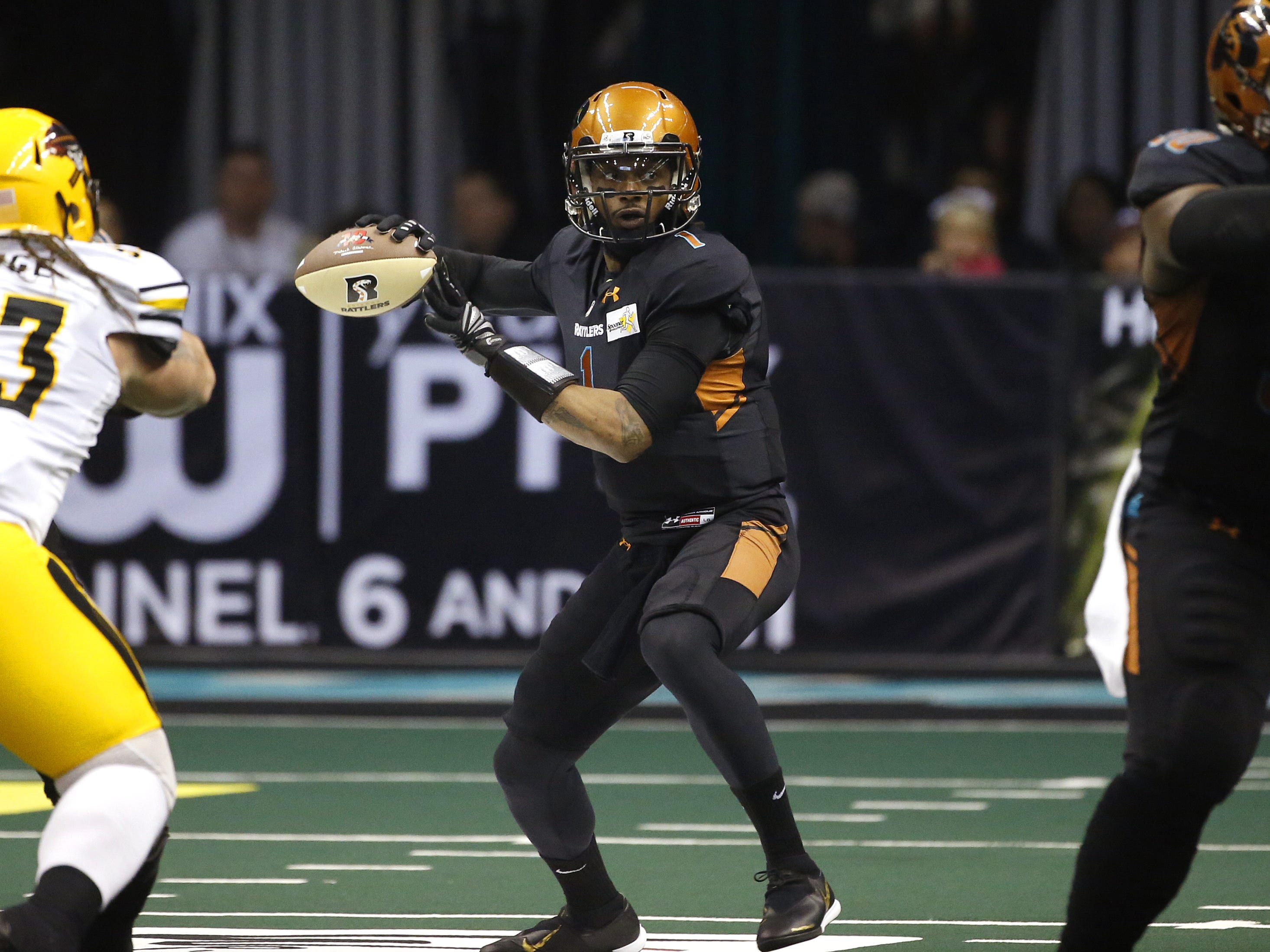 Rattlers' Verlon Reed Jr. (1) throws a pass under pressure from Sugar Skulls' Michael Kluge (93) during the first half at Talking Stick Resort Arena in Phoenix, Ariz. on March 16, 2019.
