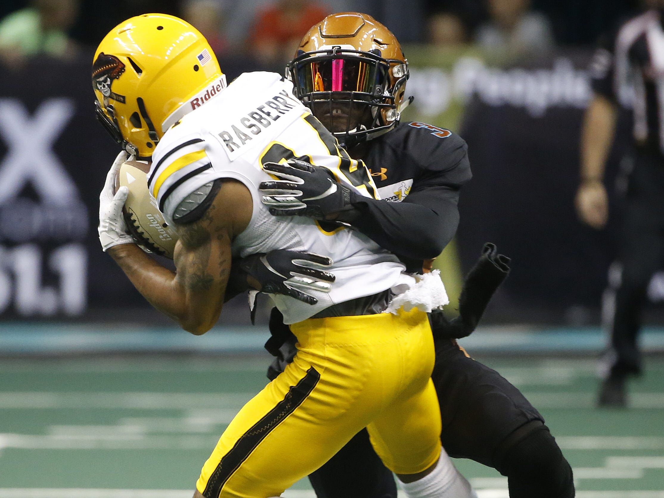 Rattlers' Allen Chapman (3) tackles Sugar Skulls Donovan Rasberry (84) during the first half at Talking Stick Resort Arena in Phoenix, Ariz. on March 16, 2019.