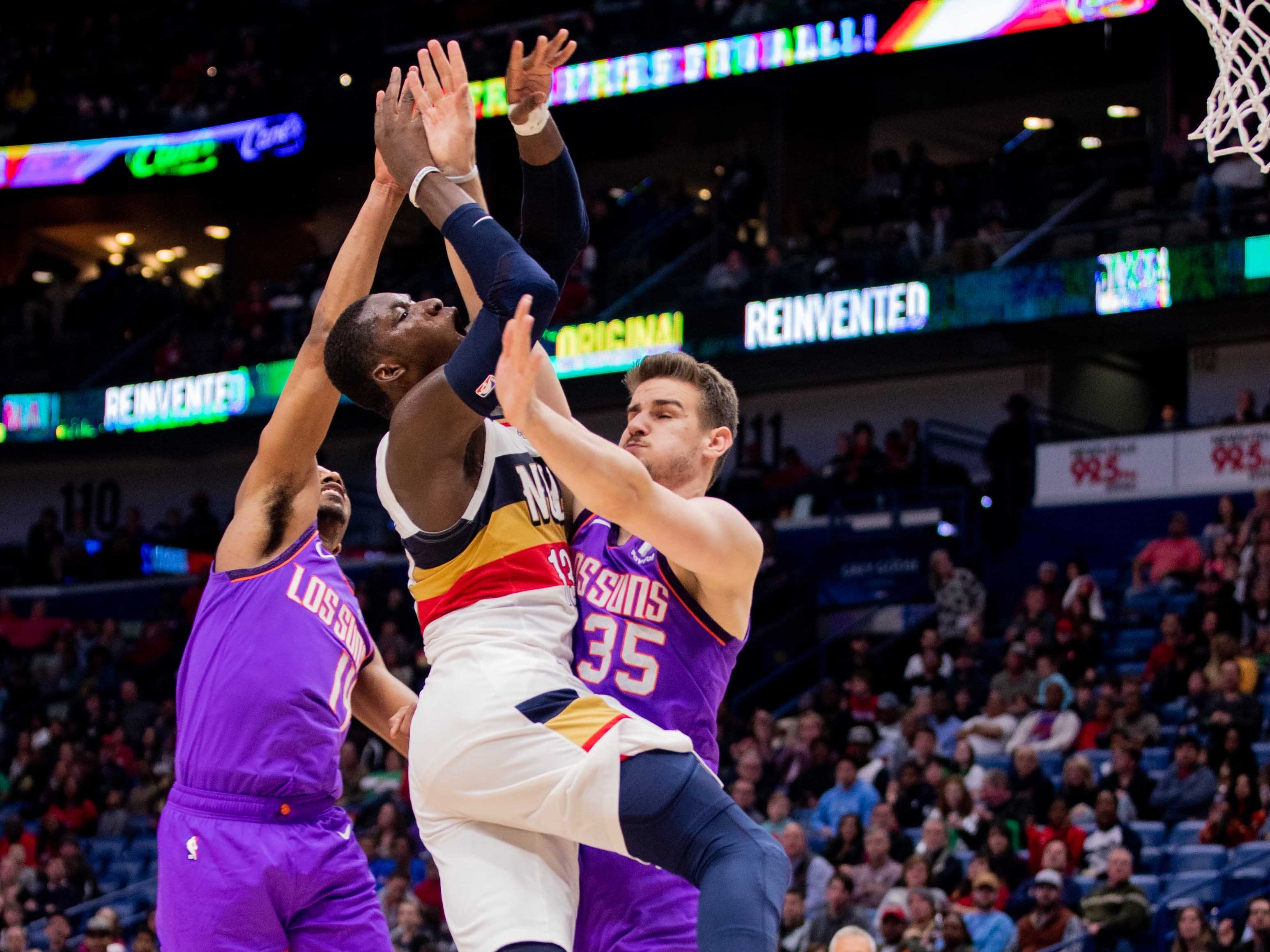 Mar 16, 2019; New Orleans, LA, USA; New Orleans Pelicans forward Cheick Diallo (13)vis fouled going to the basket by Phoenix Suns forward Dragan Bender (35) during the second half at Smoothie King Center.