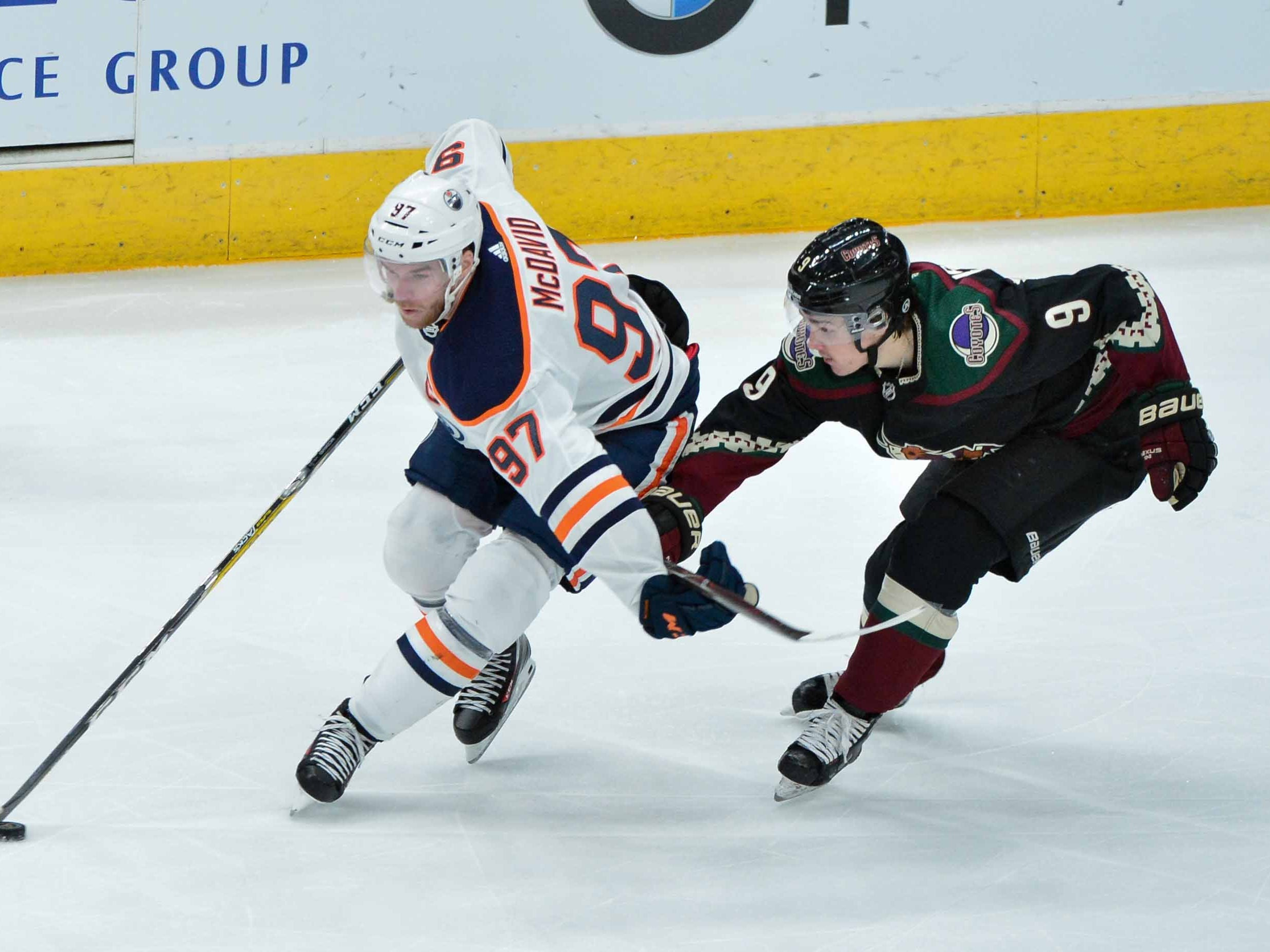 Mar 16, 2019; Glendale, AZ, USA; Edmonton Oilers center Connor McDavid (97) shields the puck from Arizona Coyotes center Clayton Keller (9) during the second period at Gila River Arena.