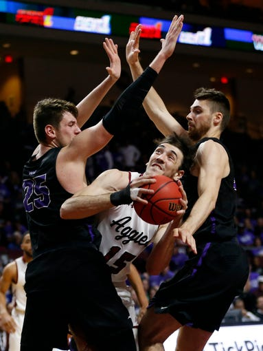 New Mexico State forward Ivan Aurrecoechea (15) looks for a shot between Grand Canyon's Alessandro Lever (25) and Matt Jackson during an NCAA college basketball game for the Western Athletic Conference men's tournament championship Saturday, March 16, 2019, in Las Vegas. New Mexico State won 89-57.