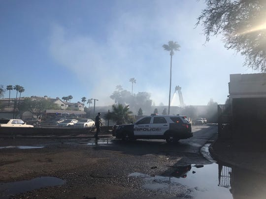 Tempe police hold a perimeter outside Doc and Eddy's sports bar on Rural and Baseline Roads as firefighters extinguish a blaze on March 17, 2019.