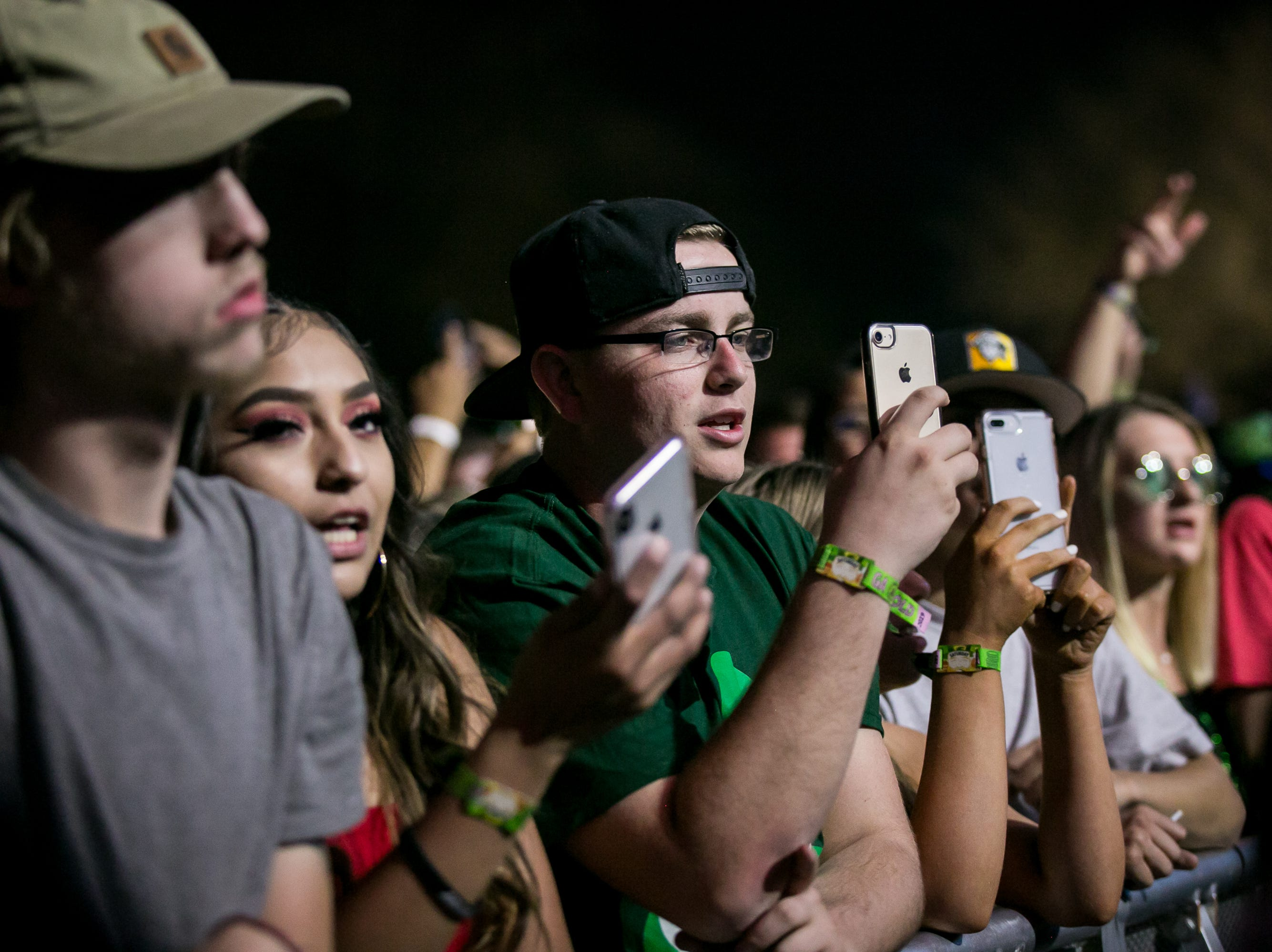Fans take photos during Pot of Gold Music Festival at Steele Indian School Park on  March 16, 2019.