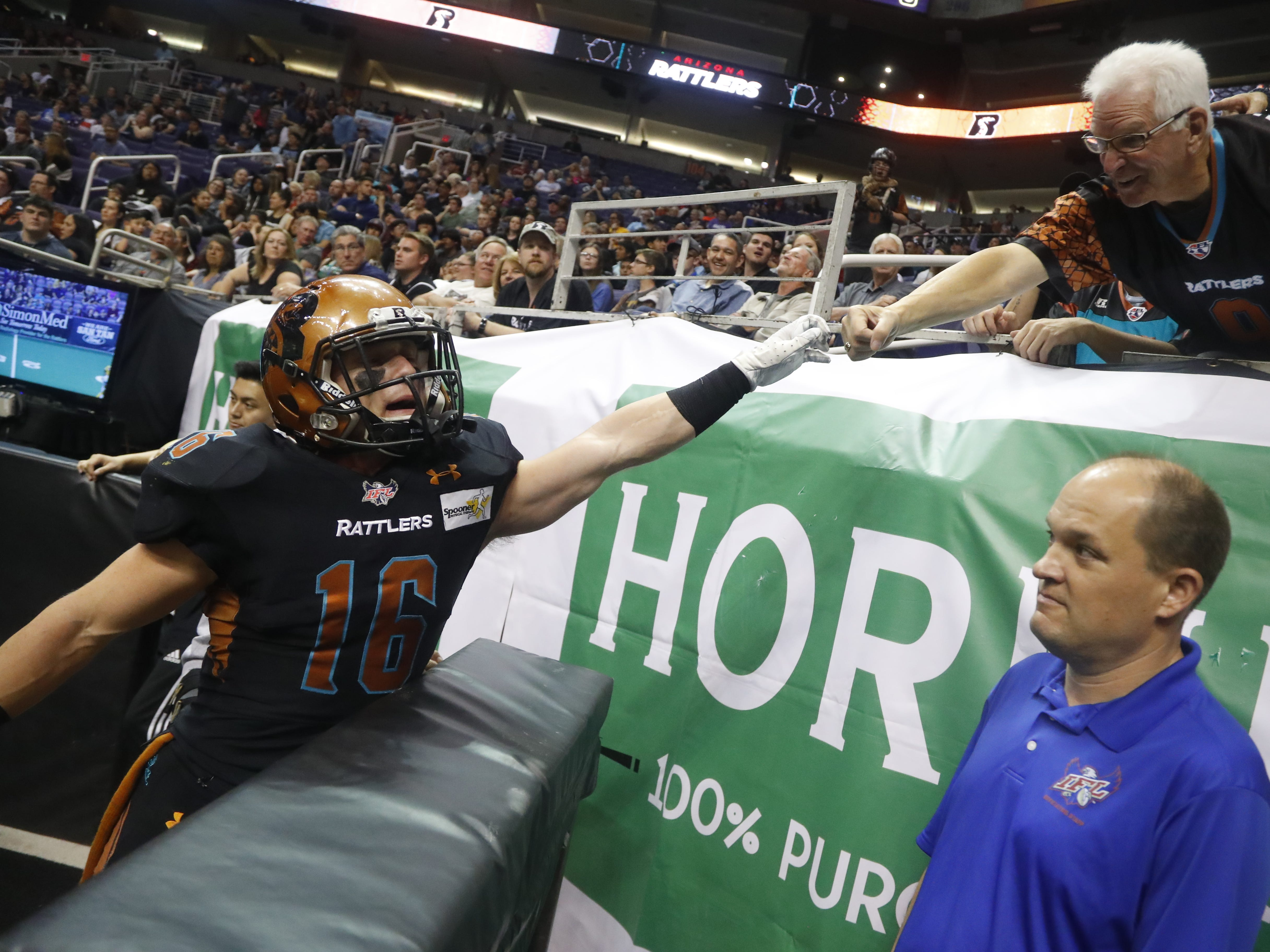 Rattlers' Jarrod Harrington (16) fist bumps a fan during the second half against the Sugar Skulls at Talking Stick Resort Arena in Phoenix, Ariz. on March 16, 2019.