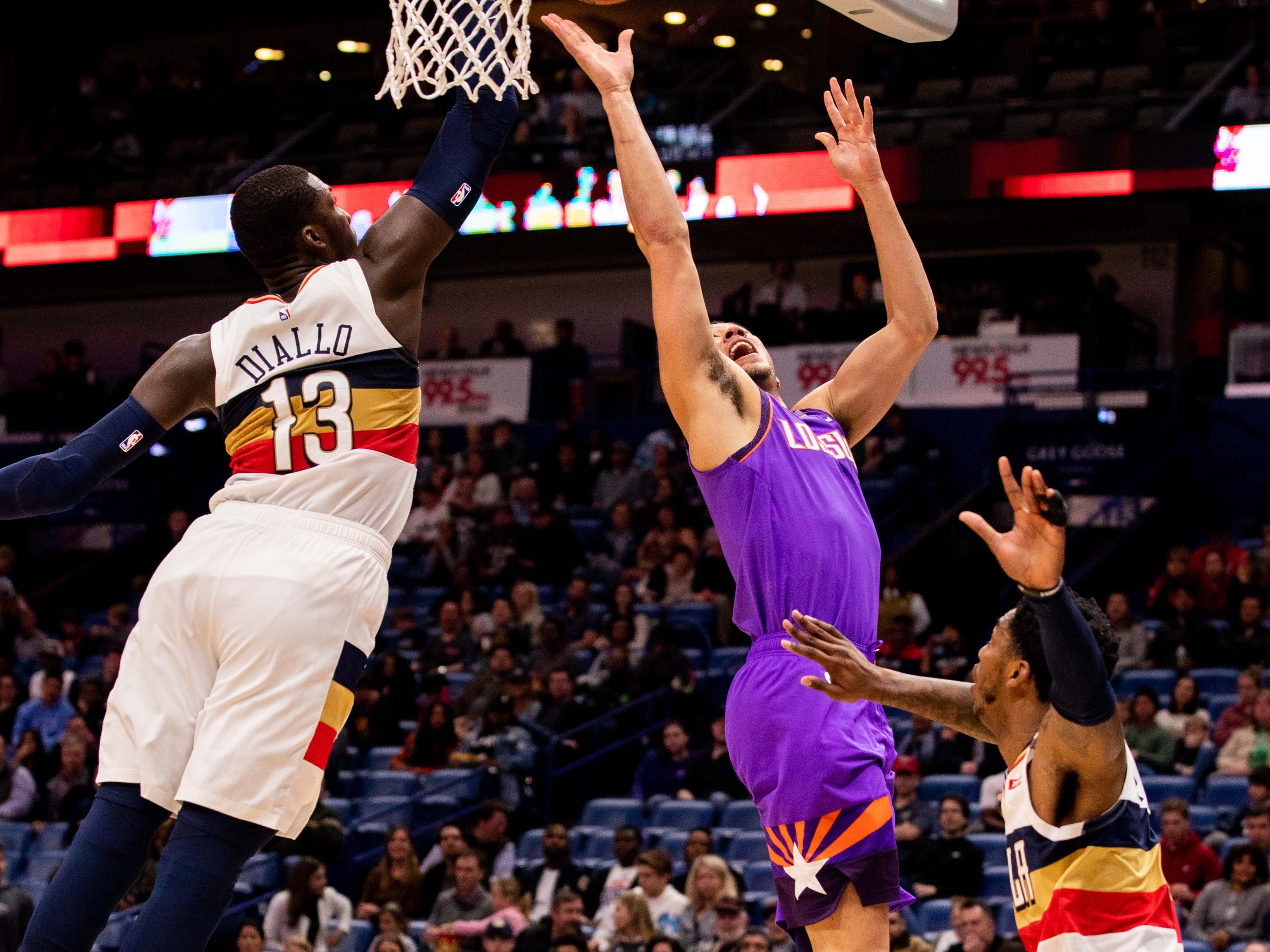 Mar 16, 2019; New Orleans, LA, USA; Phoenix Suns guard Devin Booker (1) shoots a jump shot against New Orleans Pelicans forward Cheick Diallo (13) during the first half at Smoothie King Center.