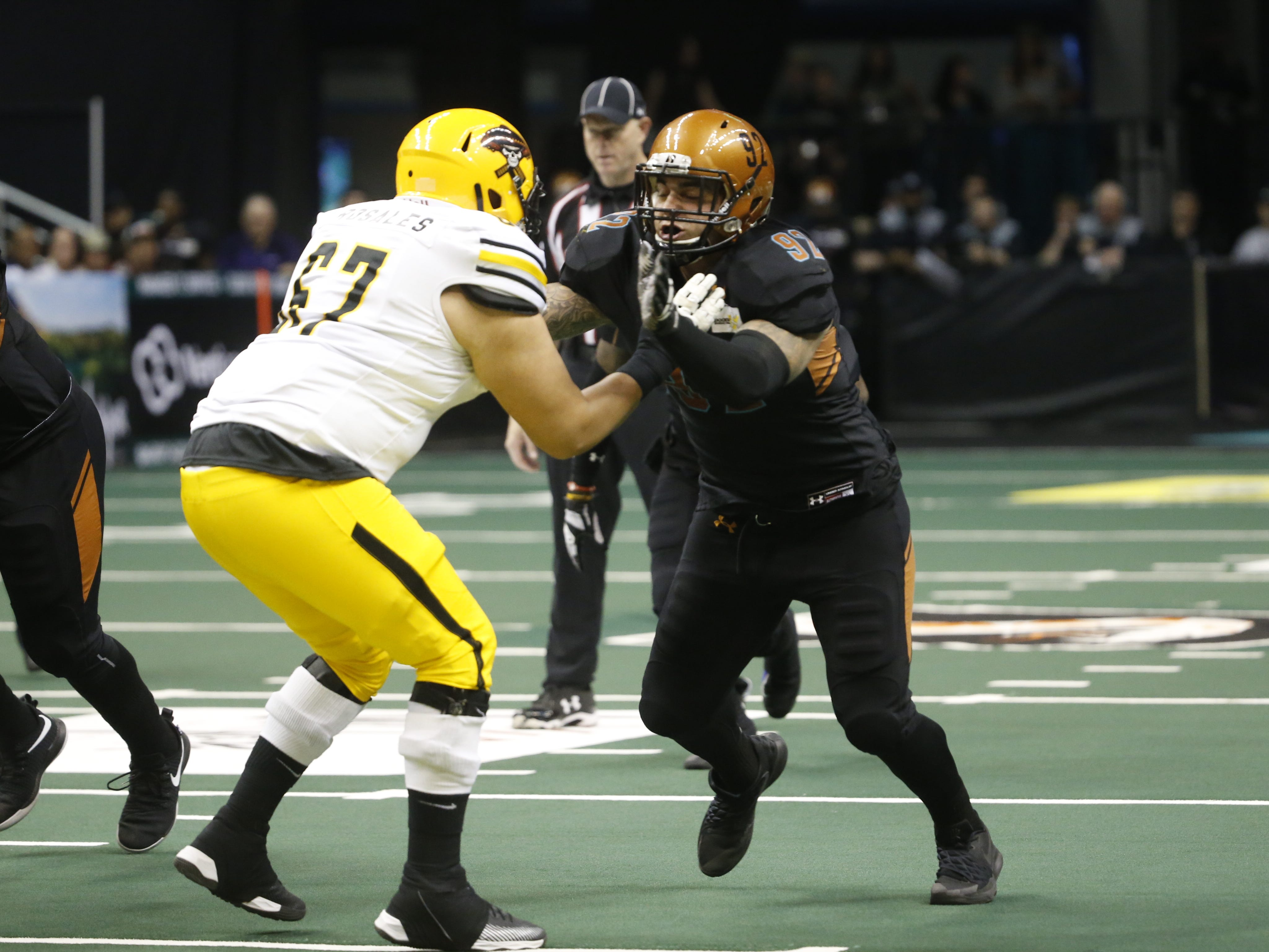 Rattlers' Nikolaus D'Avanza (92) rushes the passer against Sugar Skulls' Antonio Rosales (67) during the first half at Talking Stick Resort Arena in Phoenix, Ariz. on March 16, 2019.